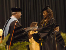 FTCC's President handing a diploma to a student at graduation